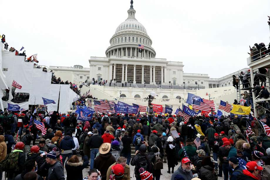 WASHINGTON, DC - JANUARY 06: Protesters gather outside the U.S. Capitol Building on January 06, 2021 in Washington, DC. Pro-Trump protesters entered the U.S. Capitol building after mass demonstrations in the nation's capital during a joint session Congress to ratify President-elect Joe Biden's 306-232 Electoral College win over President Donald Trump. (Photo by Tasos Katopodis/Getty Images) Photo: Tasos Katopodis/Getty Images / 2021 Getty Images