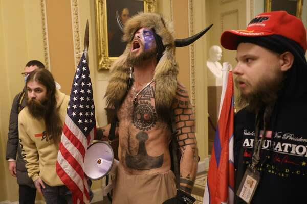 Fact check: Face-painted man in horned fur cap at Capitol riot supports  Trump and QAnon, not antifa - HoustonChronicle.com