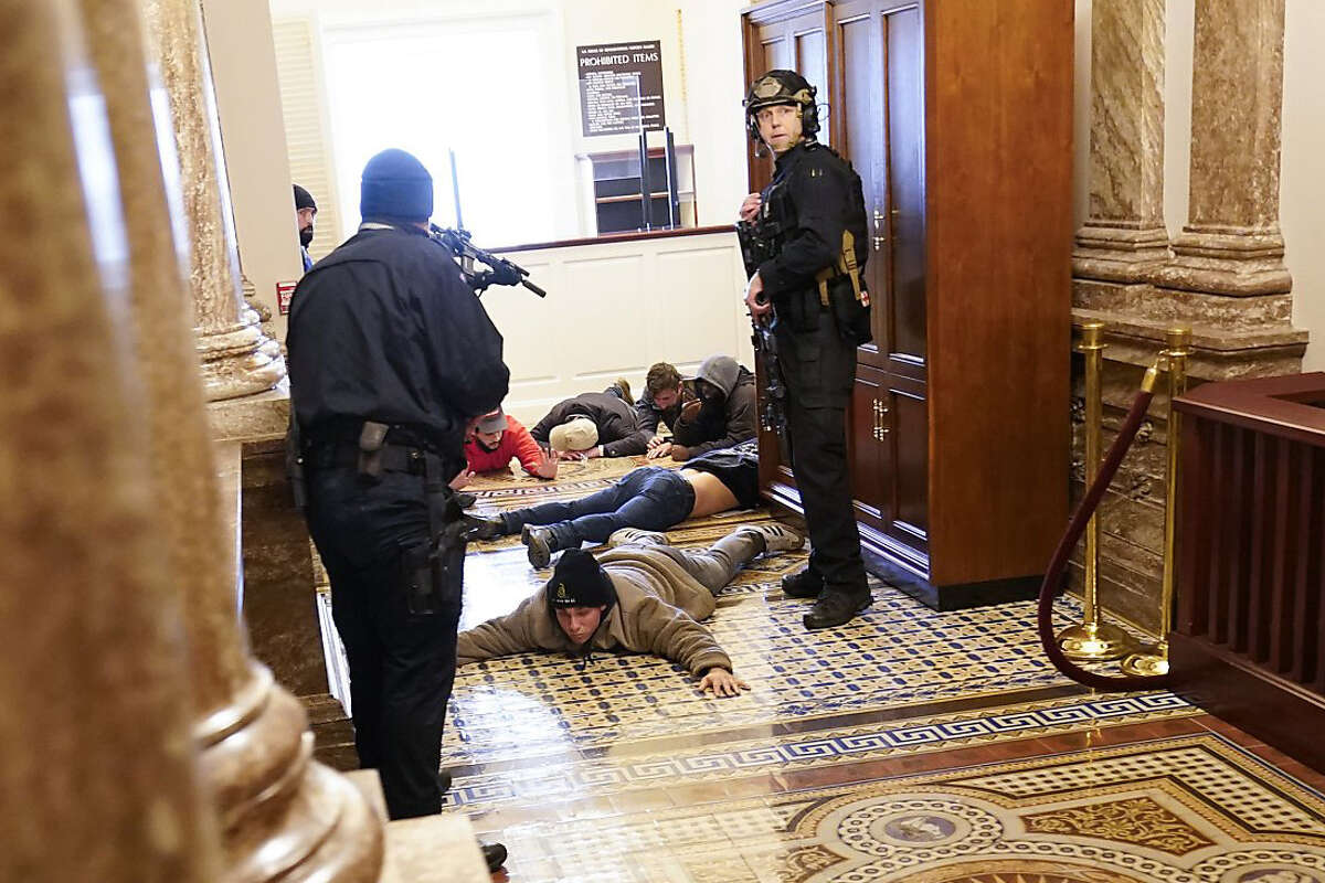 U.S. Capitol Police hold Trump supporters at gun-point near the House Chamber inside the U.S. Capitol on Wednesday, Jan. 6, 2021, in Washington.