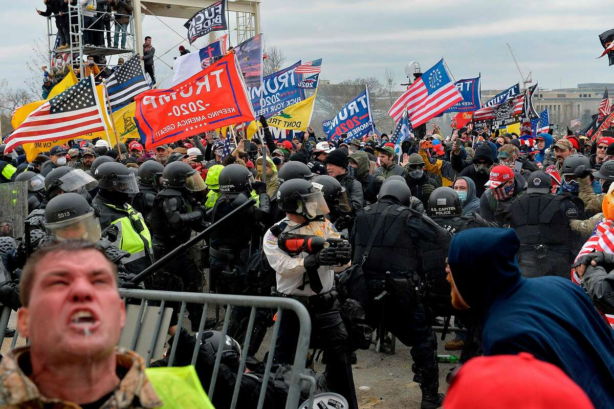 Trump supporters clash with police and security forces as people try to storm the US Capitol Building in Washington, DC, on January 6, 2021.