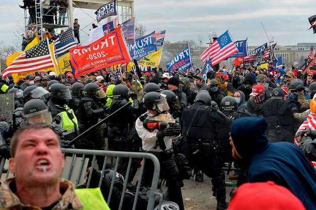 Trump supporters clash with police and security forces as people try to storm the US Capitol Building in Washington, DC, on January 6, 2021. Photo: Joseph Prezioso, AFP Via Getty Images