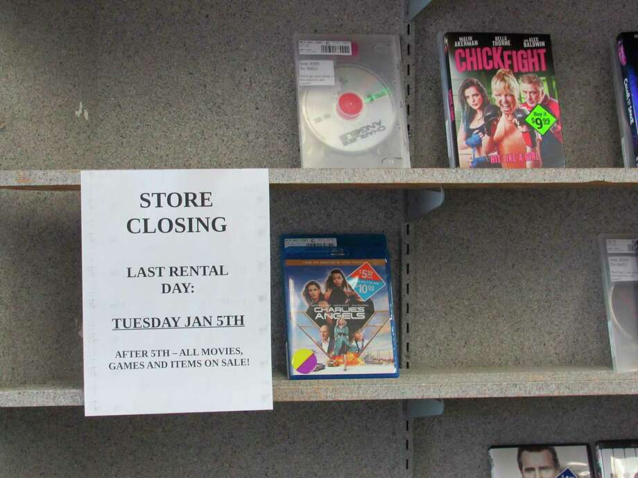 Movies line the shelves, ready for purchase as part of Family Video's closing sale on Wednesday in Midland. Family Video announced on Tuesday it is closing all of its stores. (Victoria Ritter/vritter@mdn.net)