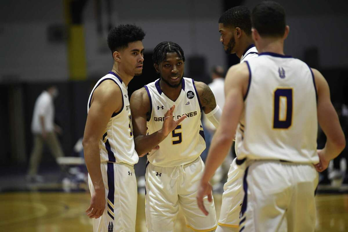 Jamel Horton (5) leads a UAlbany basketball huddle with (from left) Chuck Champion, Jarvis Doles and Antonio Rizzuto on Saturday, Dec. 19, 2020, during an America East Conference game against UMBC at SEFCU Arena. (Kathleen Helman / UAlbany athletics)
