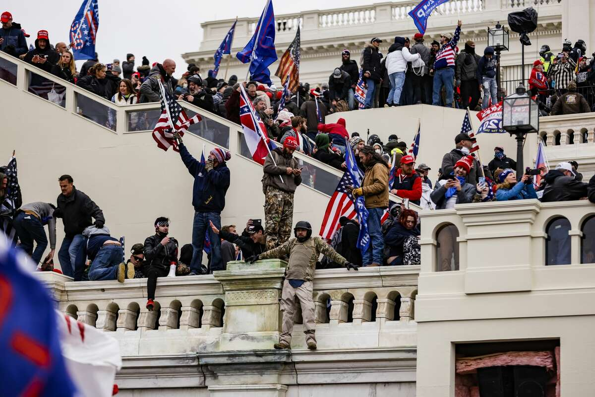 Pro-Trump supporters storm the U.S. Capitol following a rally with President Donald Trump on Wednesday, Jan. 6, 2021 in Washington, D.C.