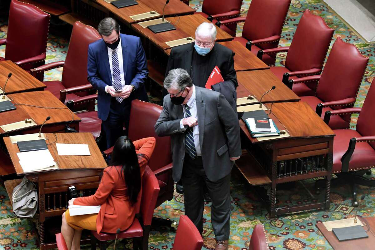 Sen. Neil Breslin offers an elbow greeting to a senate colleague during the first day of the 2021 legislative session on Wednesday, Jan. 6, 2021, in the Senate Chamber at the Capitol in Albany, N.Y. (Will Waldron/Times Union)