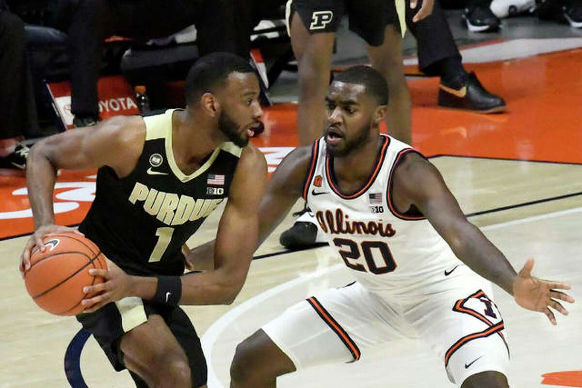 Purdue's forward Aaron Wheeler (1) is pressured by Illinois guard Da'Monte Williams (20) in the second half of an NCAA college basketball game Saturday, Jan. 2, 2021, in Champaign, Ill.