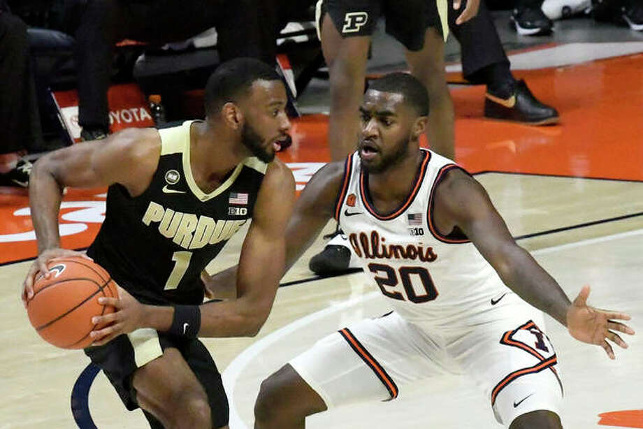 Purdue's forward Aaron Wheeler (1) is pressured by Illinois guard Da'Monte Williams (20) in the second half of an NCAA college basketball game Saturday, Jan. 2, 2021, in Champaign, Ill. Photo: Associated Press