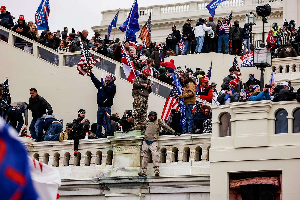 Pro-Trump supporters storm the U.S. Capitol following a rally with President Trump Wednesday.