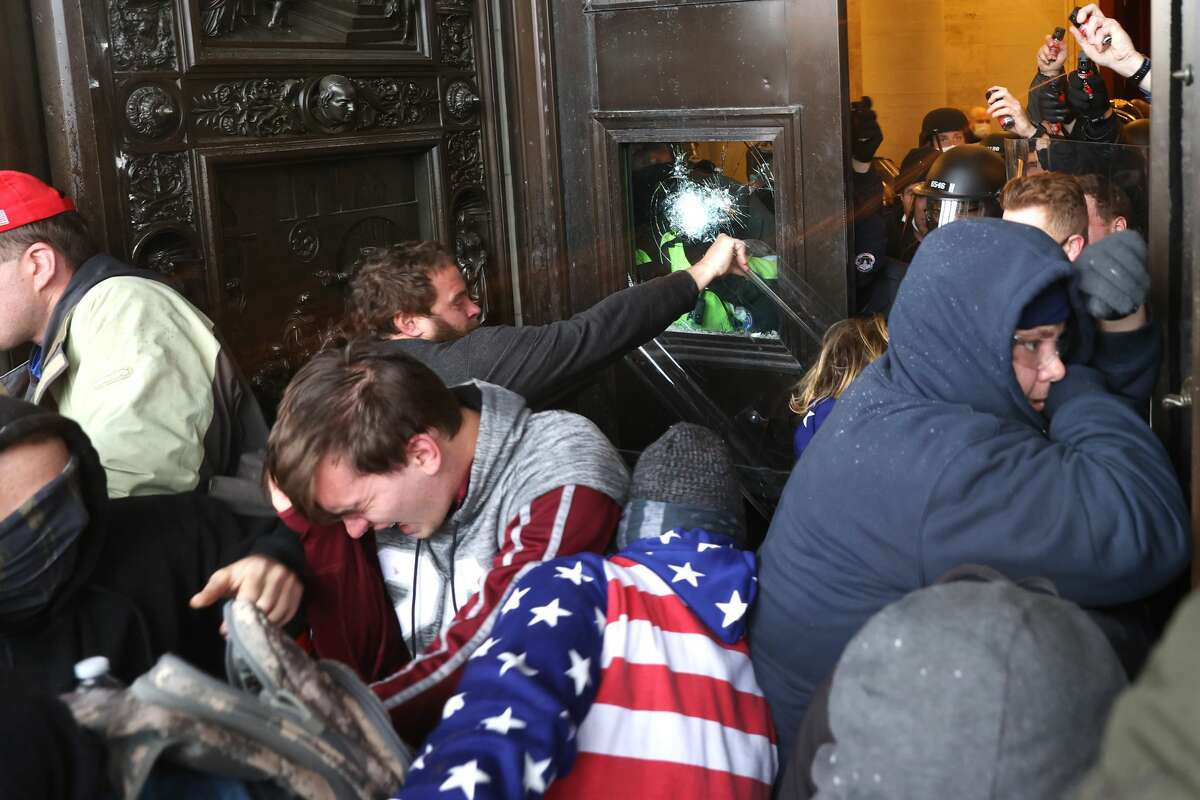 A mob of Trump supporters breaches the doors of the U.S. Capitol on Jan. 06, 2021.