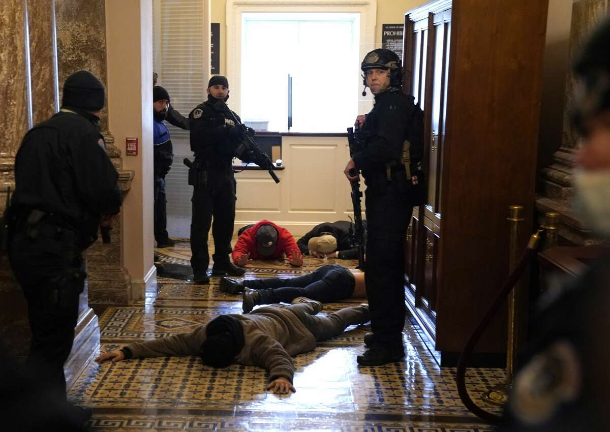U.S. Capitol Police stand detain protesters outside of the House Chamber during a joint session of Congress on January 06, 2021 in Washington, DC. Congress held a joint session today to ratify President-elect Joe Biden's 306-232 Electoral College win over President Donald Trump. A group of Republican senators said they would reject the Electoral College votes of several states unless Congress appointed a commission to audit the election results. (Photo by Drew Angerer/Getty Images)