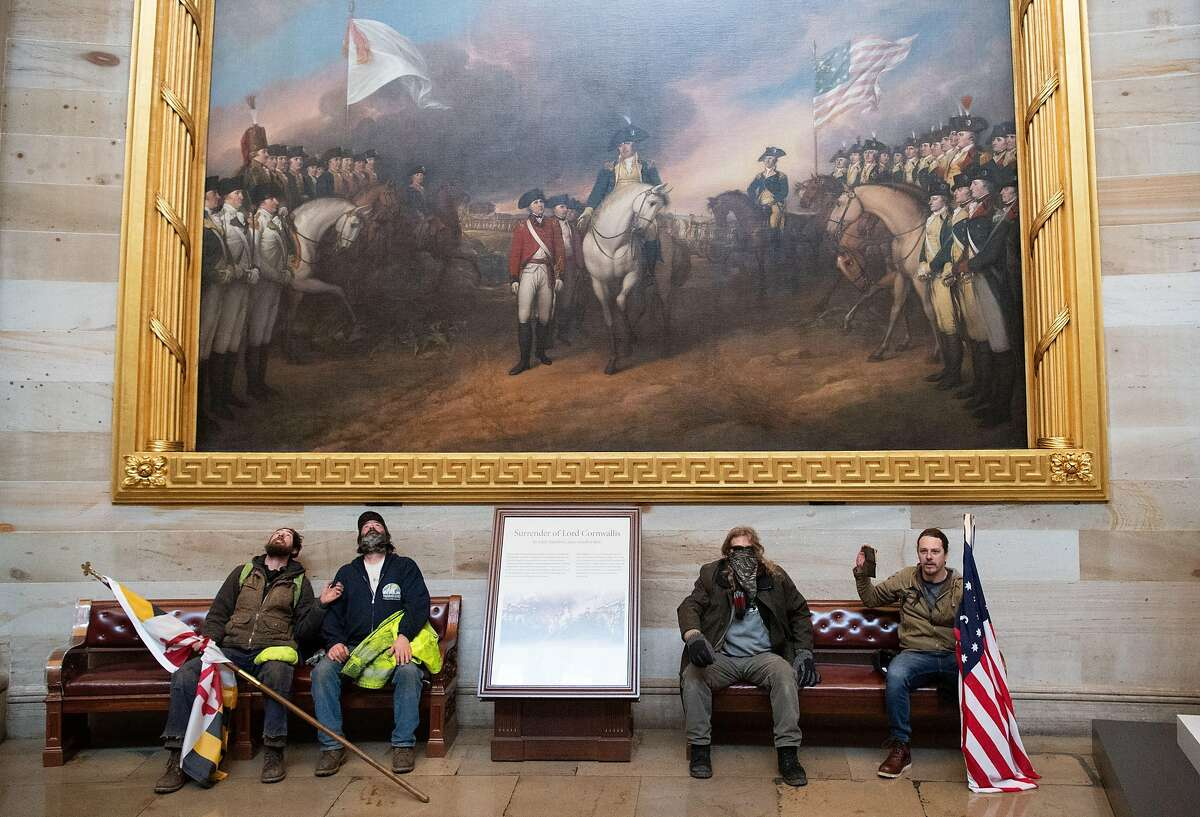 Supporters of President Donald Trump sit in the US Capitol Rotunda on January 6, 2021, in Washington, DC.