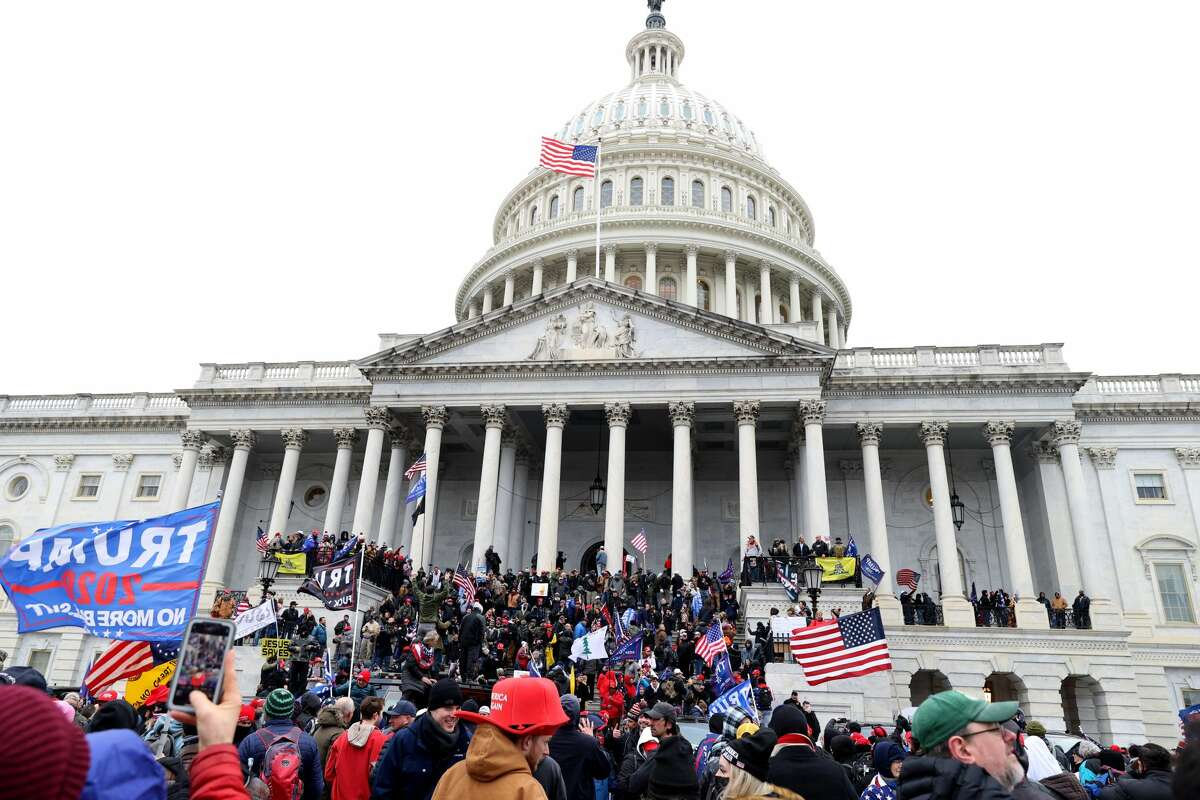WASHINGTON, DC - JANUARY 06: Protesters gather on the U.S. Capitol Building on January 06, 2021 in Washington, DC. Pro-Trump protesters entered the U.S. Capitol building after mass demonstrations in the nation's capital during a joint session Congress to ratify President-elect Joe Biden's 306-232 Electoral College win over President Donald Trump. (Photo by Tasos Katopodis/Getty Images)