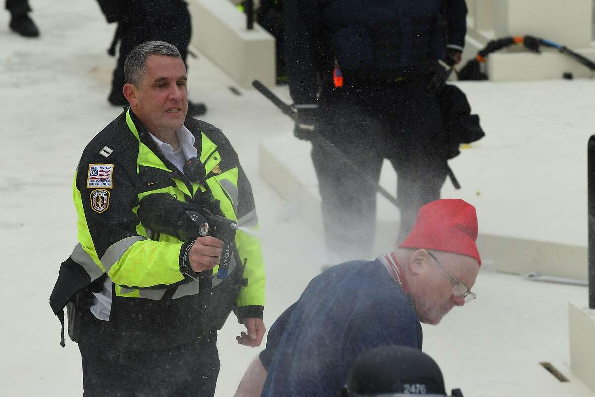 Trump supporters clash with police and security forces as they invade the Inauguration platform of the US Capitol in Washington, DC on January 6, 2021.