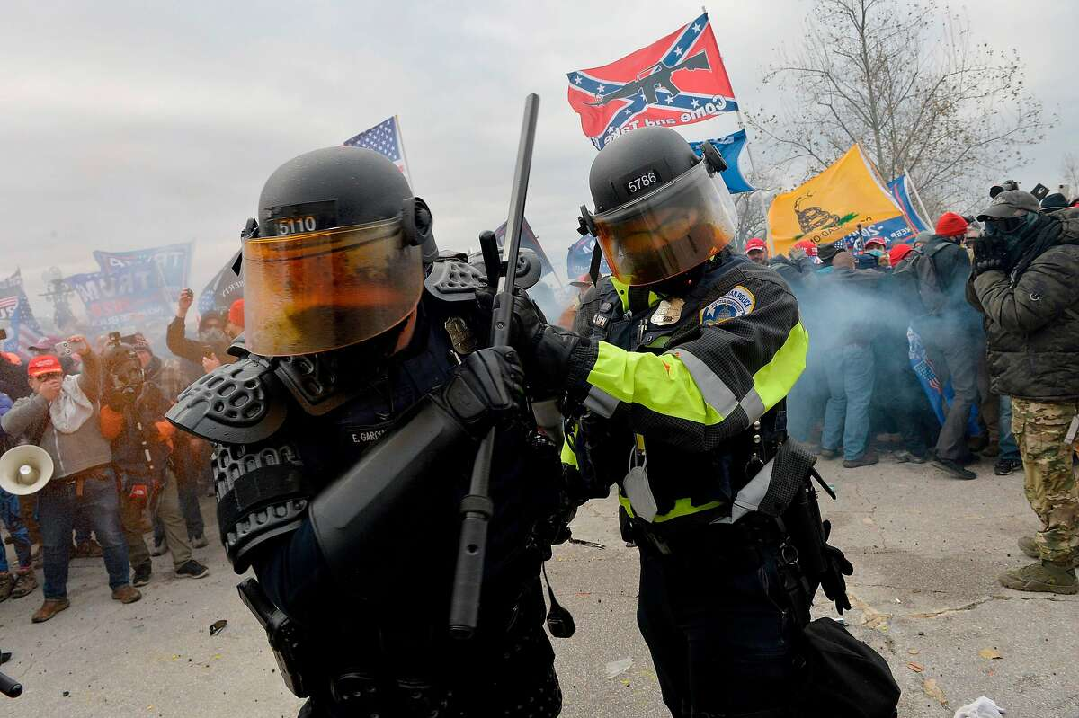 Trump supporters clash with police and security forces as they try to storm the US Capitol in Washington, DC on January 6, 2021.