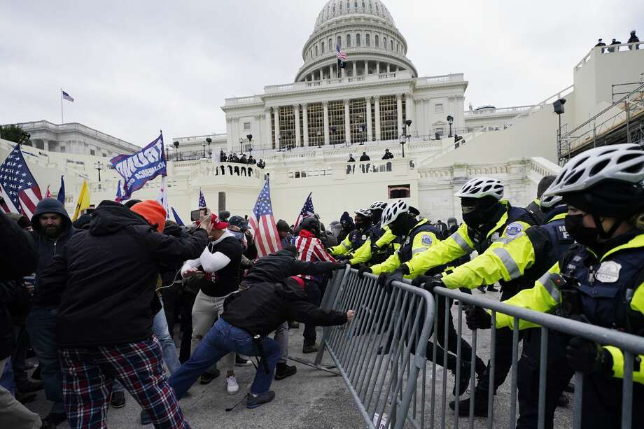Trump supporters try to break through a police barrier, Wednesday, Jan. 6, 2021, at the Capitol in Washington. As Congress prepares to affirm President-elect Joe Biden's victory, thousands of people have gathered to show their support for President Donald Trump and his claims of election fraud. (AP Photo/Julio Cortez) Photo: Julio Cortez/Associated Press / Copyright 2021 The Associated Press. All rights reserved.