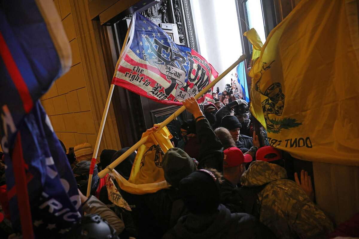Protesters supporting U.S. President Donald Trump break into the U.S. Capitol on Jan. 6.