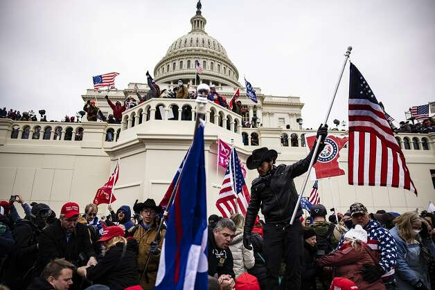 Pro-Trump supporters storm the U.S. Capitol following a rally with President Donald Trump on January 6, 2021 in Washington, DC. Photo: Samuel Corum, Getty Images