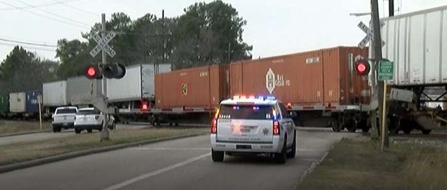 Harris County Sheriff's Office cruisers are seen at a crossing intersection in the Old Humble Road area where a Union Pacific train stopped after crew members realized the locomotive struck a bicyclist in Porter. Photo: Courtesy Of The Montgomery County Police Reporter