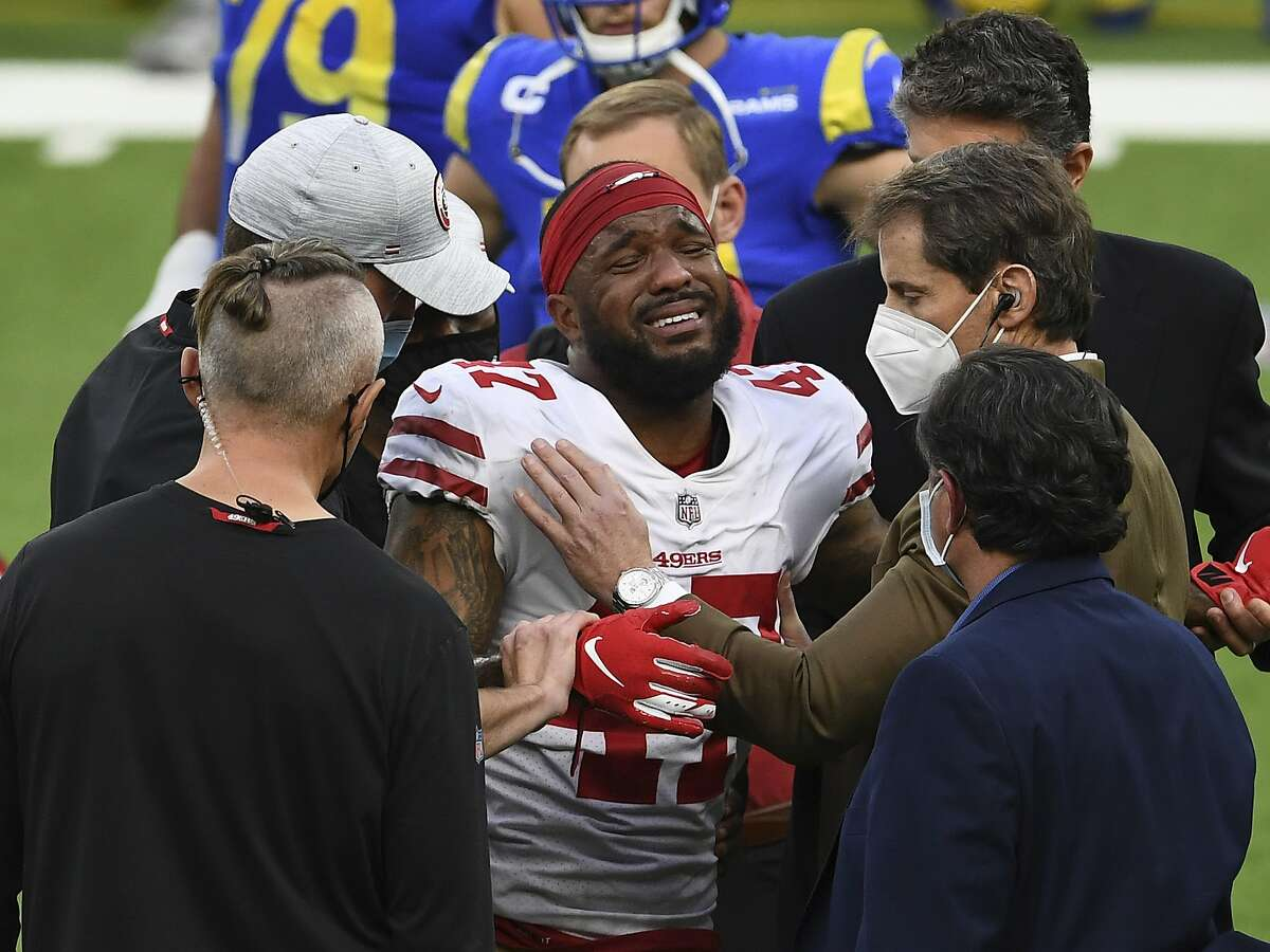 San Francisco cornerback Jamar Taylor is helped off the field after getting injured against the Rams on Nov. 29.