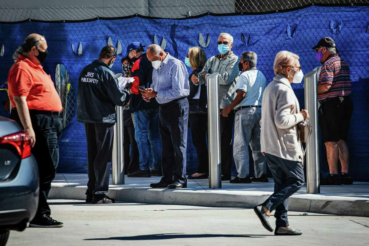 People wait in line for coronavirus vaccines at the Christine E. Lynn Rehabilitation Center at Jackson Memorial Hospital in Miami, on Wednesday, Jan. 6, 2021. (Scott McIntyre/The New York Times)