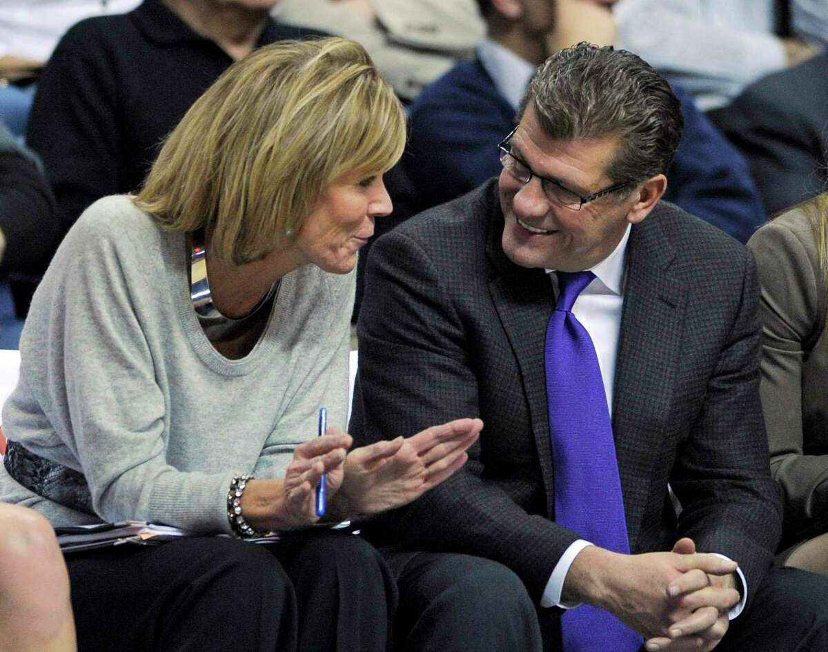 Connecticut coaches Chris Dailey, left, and Geno Auriemma talk during the second half of Connecticut's 93-40 victory over Fairfield in an NCAA college basketball game in Storrs, Conn., on Thursday, Dec. 29, 2011. (AP Photo/Fred Beckham)