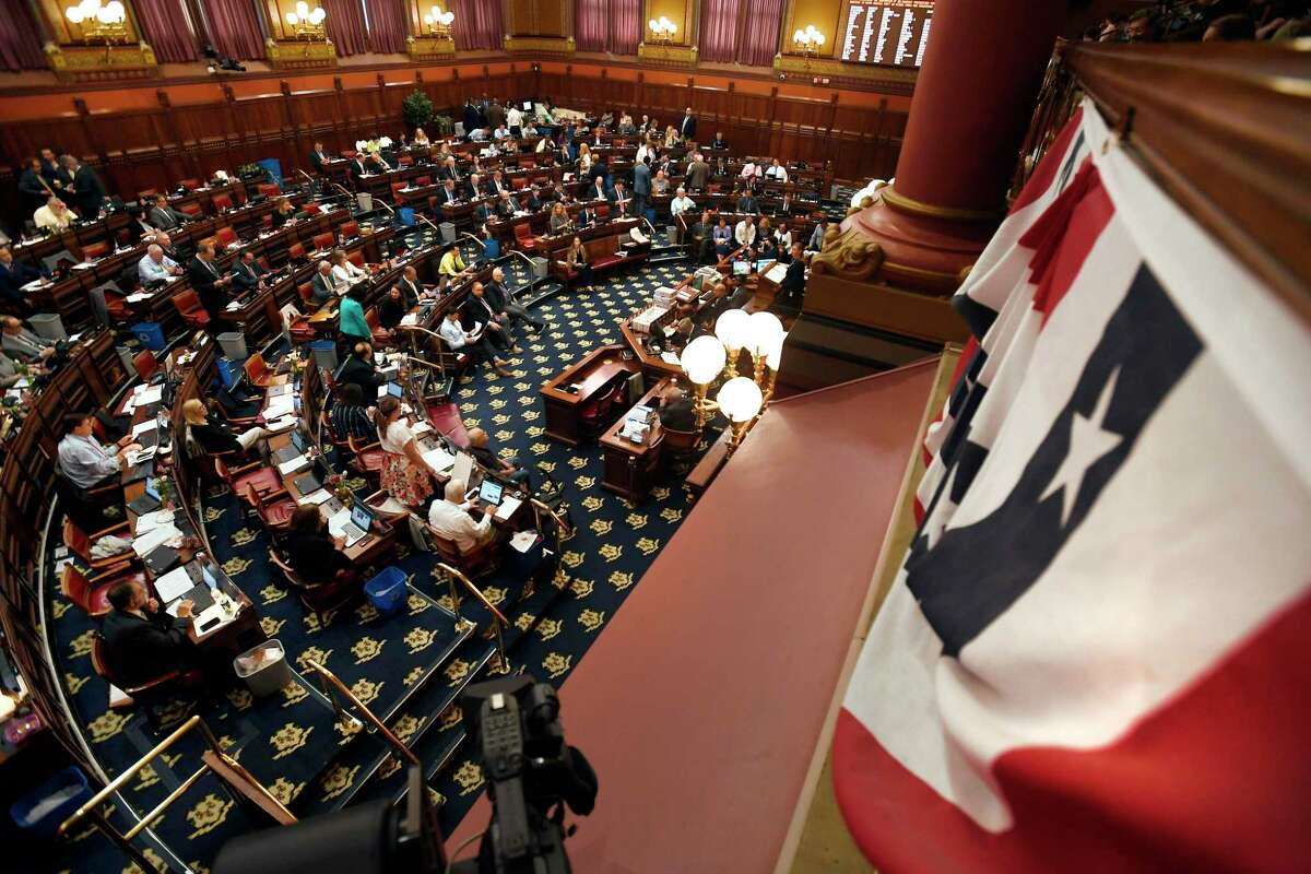 In this June 5, 2019, file photo, legislators meet inside the Hall of the House during the final day of session at the State Capitol in Hartford.