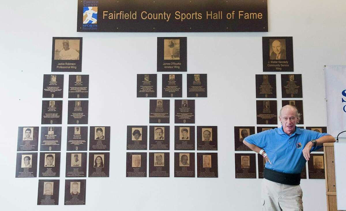 Bill Mongovan speaks on behalf of Ceci Hopp St. Geme, a Greenwich High School graduate as she is inducted into the Fairfield County Sports Hall of Fame on June 30, 2011.
