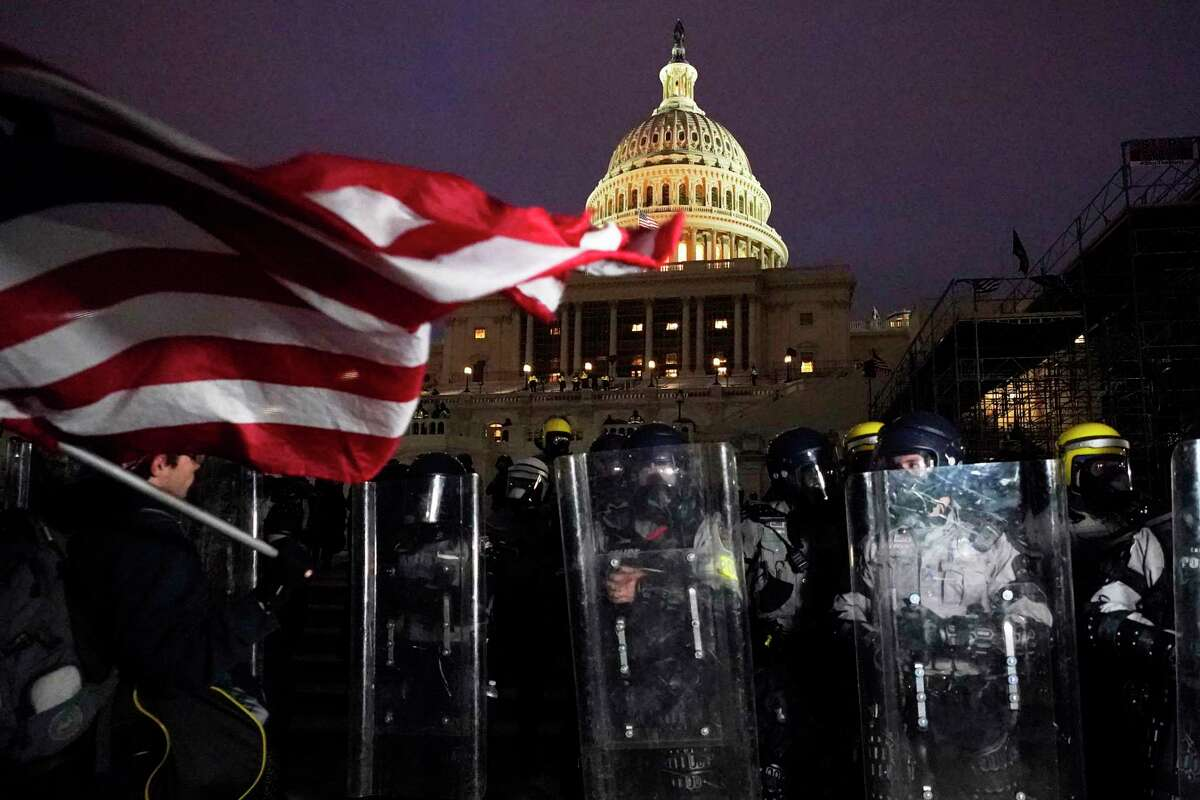Police stand outside the Capitol after a day of rioting protesters, Wednesday, Jan. 6, 2021, at the Capitol in Washington. (AP Photo/Julio Cortez)