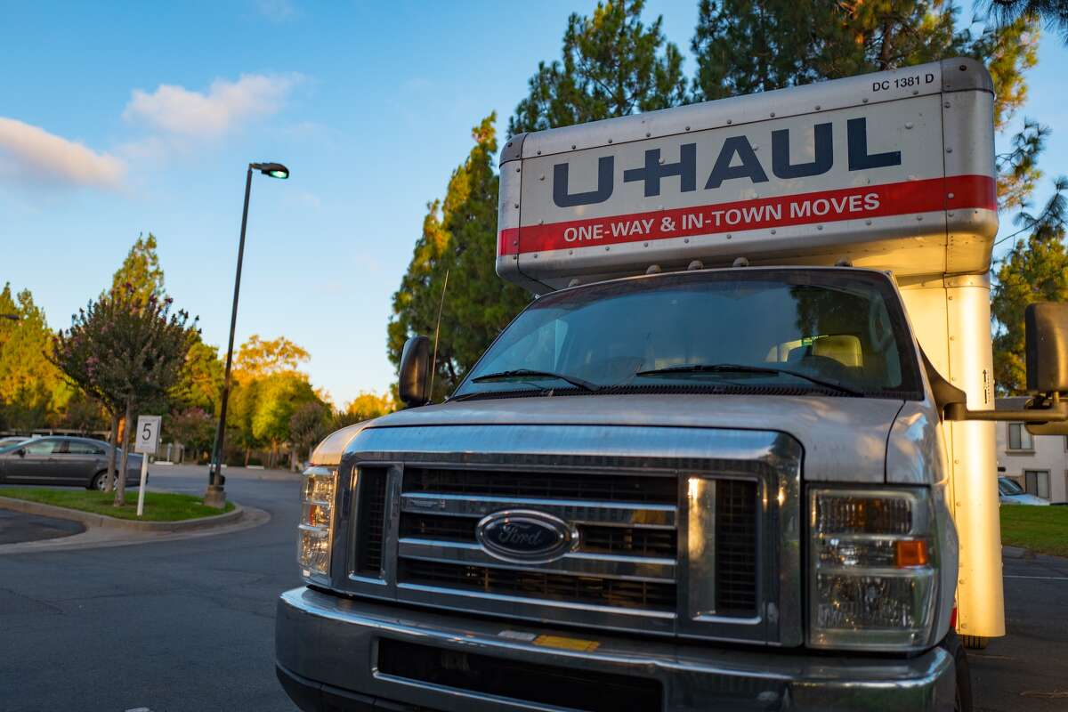 Front view of a U-Haul moving truck in the parking lot of an apartment complex in the San Francisco Bay Area, California, September 12, 2016. In 2014-2015, more than 90,000 new residents moved to the Bay Area, one of the largest population increases on record for the region. (Photo via Smith Collection/Gado/Getty Images).
