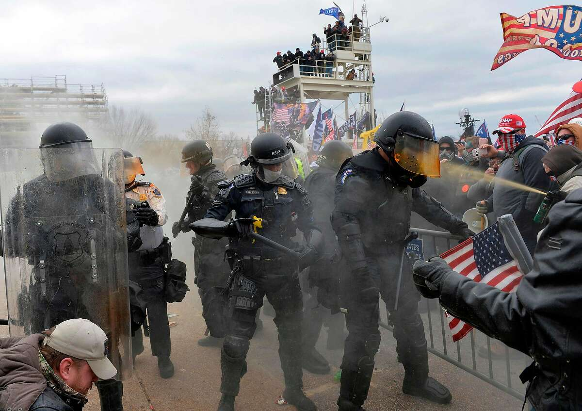 TOPSHOT - Trump supporters clash with police and security forces as they try to storm the US Capitol in Washington, DC on January 6, 2021. - Demonstrators breeched security and entered the Capitol as Congress debated the a 2020 presidential election Electoral Vote Certification. (Photo by Joseph Prezioso / AFP) (Photo by JOSEPH PREZIOSO/AFP via Getty Images)