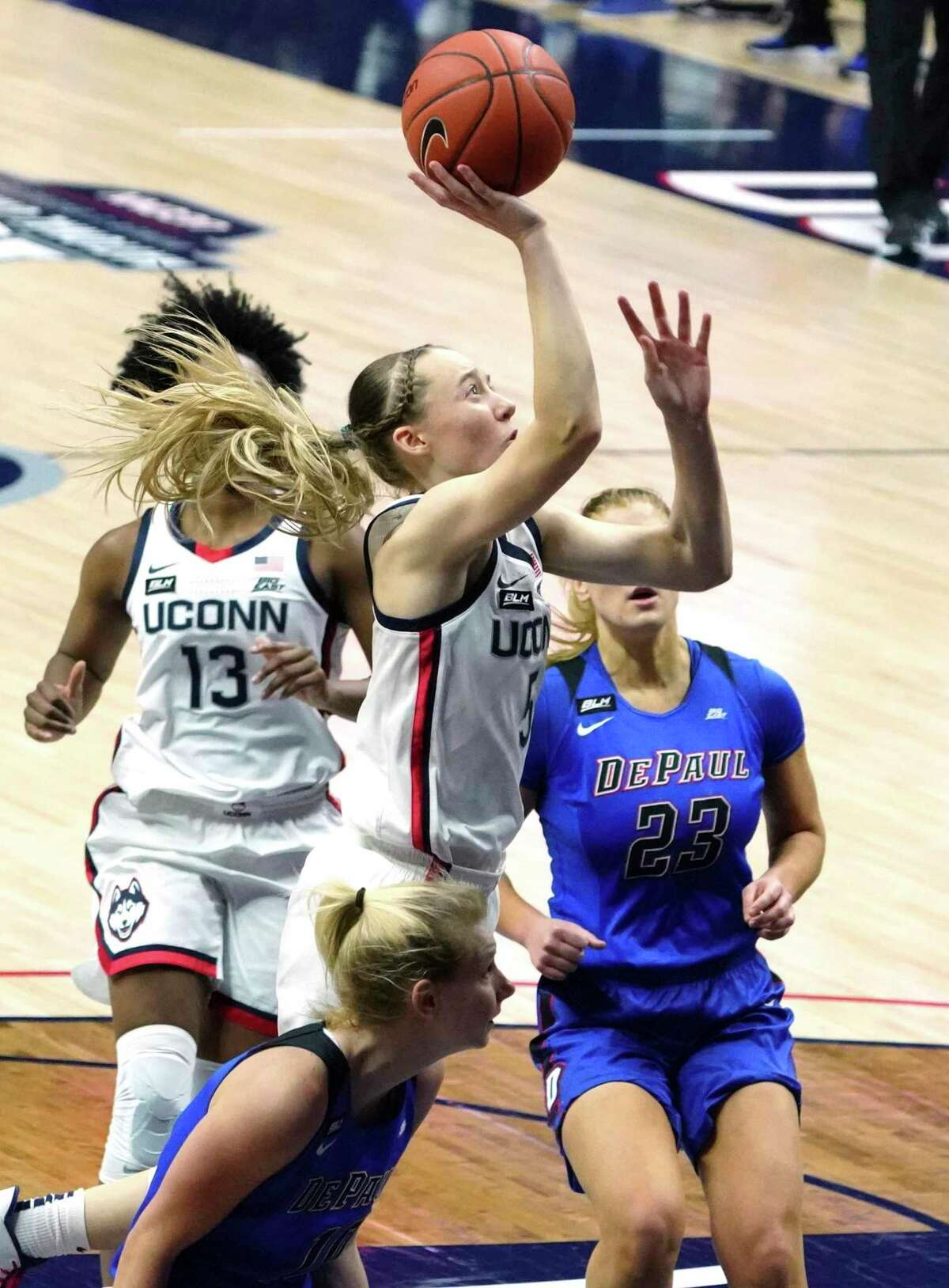 Connecticut guard Paige Bueckers (5) drives to the basket against DePaul during the second halfof an NCAA college basketball game Tuesday, Dec. 29, 2020, in Storrs, Conn. (David Butler II/Pool Photo via AP