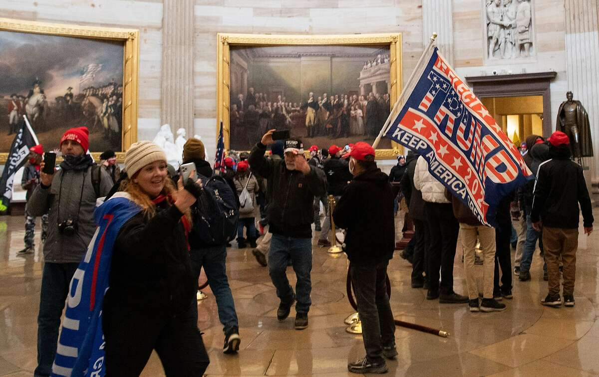 Former mayoral candidate Jenny Cudd (bottom left) was among the protesters that made their way into the U.S. Capitol building Wednesday afternoon as some breached the floors of the House and Senate, causing lawmakers to be evacuated. (Photo by SAUL LOEB / AFP) (Photo by SAUL LOEB/AFP via Getty Images)