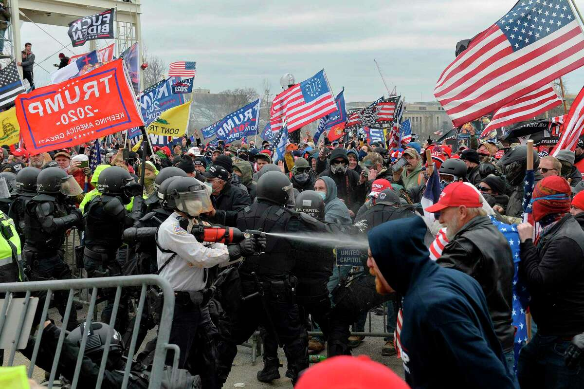 Extremists opposed to democracy and in support of President Donald Trump clash with police and security forces as they storm the U.S. Capitol on Wednesday. This was not a nonviolent protest nor an act of civil disobedience to dramatize an injustice for which they'd be willing to go to jail.