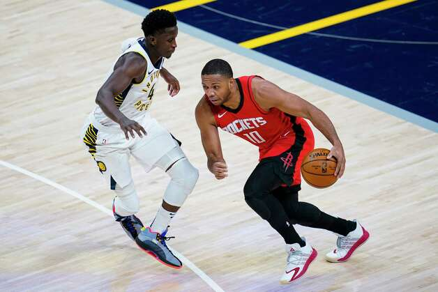 Houston Rockets guard Eric Gordon (10) drives on Indiana Pacers guard Victor Oladipo (4) during the third quarter of an NBA basketball game in Indianapolis, Wednesday, Jan. 6, 2021. (AP Photo/Michael Conroy) Photo: Michael Conroy, Associated Press / Copyright 2021 The Associated Press. All rights reserved.