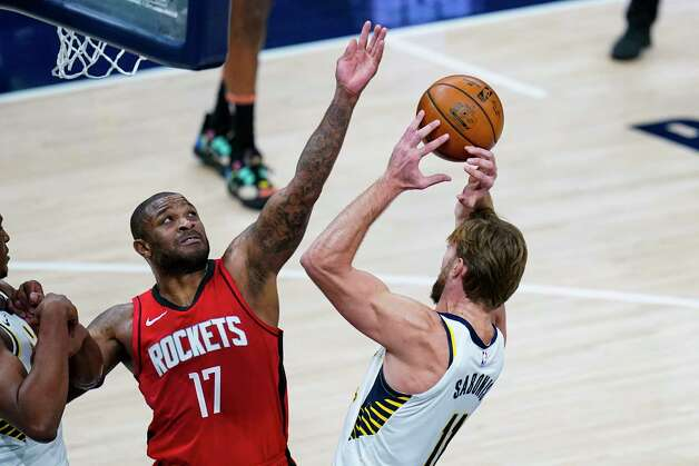 Indiana Pacers forward Domantas Sabonis (11) and Houston Rockets forward P.J. Tucker (17) go up for a rebound during the third quarter of an NBA basketball game in Indianapolis, Wednesday, Jan. 6, 2021. (AP Photo/Michael Conroy) Photo: Michael Conroy, Associated Press / Copyright 2021 The Associated Press. All rights reserved.