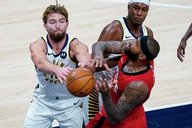 Houston Rockets center DeMarcus Cousins (15) and Indiana Pacers forward Domantas Sabonis (11) fight for a rebound during the third quarter of an NBA basketball game in Indianapolis, Wednesday, Jan. 6, 2021. (AP Photo/Michael Conroy) Photo: Michael Conroy, Associated Press / Copyright 2021 The Associated Press. All rights reserved.