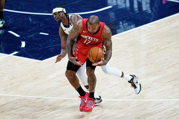 Houston Rockets forward P.J. Tucker (17) steals the ball from Indiana Pacers guard Justin Holiday (8) during the second quarter of an NBA basketball game in Indianapolis, Wednesday, Jan. 6, 2021. (AP Photo/Michael Conroy) Photo: Michael Conroy, Associated Press / Copyright 2021 The Associated Press. All rights reserved.