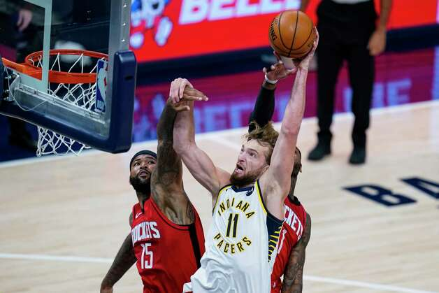 Indiana Pacers forward Domantas Sabonis (11) shoots over Houston Rockets center DeMarcus Cousins (15) during the first quarter of an NBA basketball game in Indianapolis, Wednesday, Jan. 6, 2021. (AP Photo/Michael Conroy) Photo: Michael Conroy, Associated Press / Copyright 2021 The Associated Press. All rights reserved.