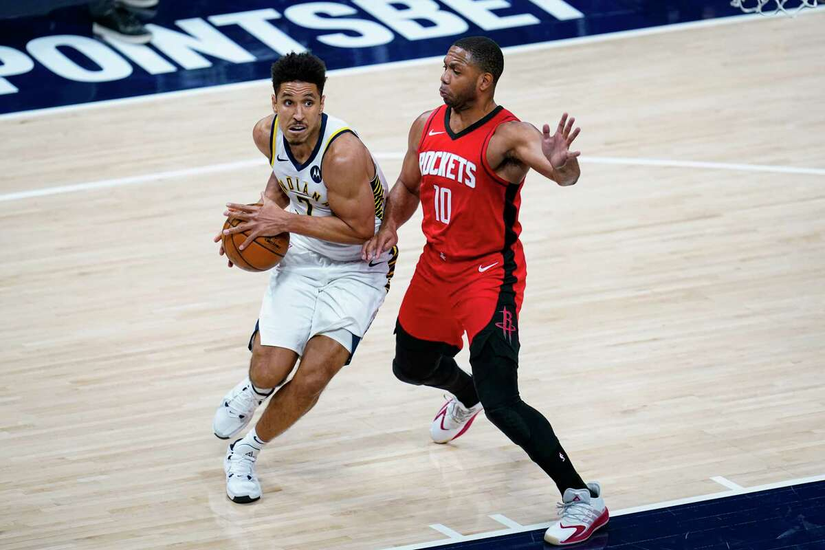 Indiana Pacers guard Malcolm Brogdon (7) drives on Houston Rockets guard Eric Gordon (10) during the second quarter of an NBA basketball game in Indianapolis, Wednesday, Jan. 6, 2021. (AP Photo/Michael Conroy)