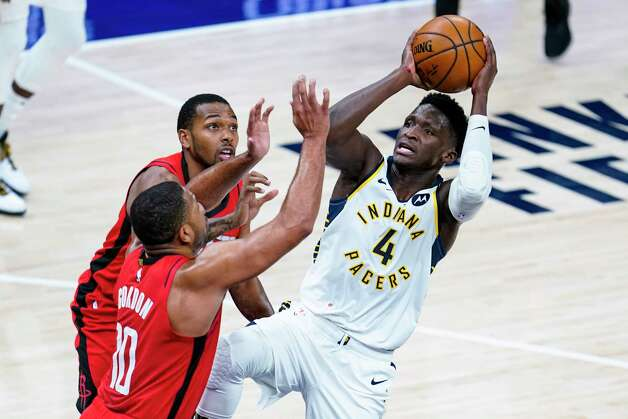 Indiana Pacers guard Victor Oladipo (4) shoots over Houston Rockets guard Eric Gordon (10) during the second quarter of an NBA basketball game in Indianapolis, Wednesday, Jan. 6, 2021. (AP Photo/Michael Conroy) Photo: Michael Conroy, Associated Press / Copyright 2021 The Associated Press. All rights reserved.