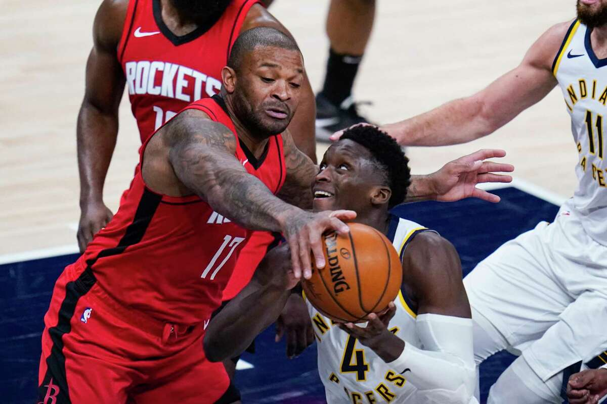 Houston Rockets forward P.J. Tucker (17) blocks the shot of Indiana Pacers guard Victor Oladipo (4) during the second quarter of an NBA basketball game in Indianapolis, Wednesday, Jan. 6, 2021. (AP Photo/Michael Conroy)