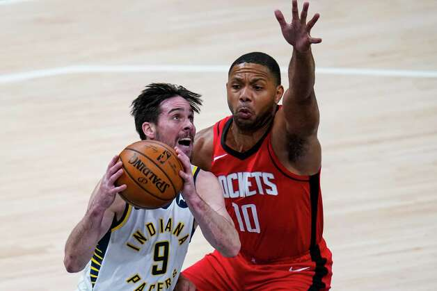 Indiana Pacers guard T.J. McConnell (9) shoots over Houston Rockets guard Eric Gordon (10) during the second quarter of an NBA basketball game in Indianapolis, Wednesday, Jan. 6, 2021. (AP Photo/Michael Conroy) Photo: Michael Conroy, Associated Press / Copyright 2021 The Associated Press. All rights reserved.