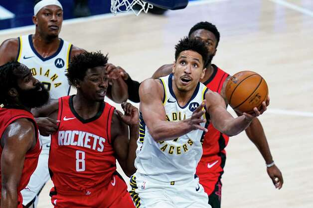 Indiana Pacers guard Malcolm Brogdon (7) shoots in front of Houston Rockets forward Jae'Sean Tate (8) during the first quarter of an NBA basketball game in Indianapolis, Wednesday, Jan. 6, 2021. (AP Photo/Michael Conroy) Photo: Michael Conroy, Associated Press / Copyright 2021 The Associated Press. All rights reserved.