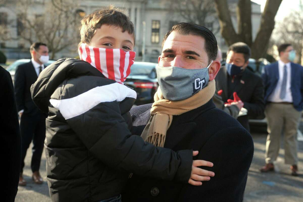 New State Sen. Paul Cicarella, R-North Haven, stands with son, Paul, during the of the start the legislative session held outside at the State Capitol, in Hartford, Conn. Jan. 6, 2021.
