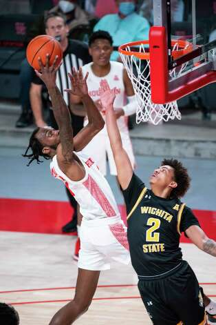 Houston Cougars guard DeJon Jarreau (3) shoots over Wichita State Shockers guard Craig Porter Jr. (2) during the first half of a game between the University of Houston Cougars and the Wichita State Shockers on Wednesday, Jan. 6, 2021, at the Feritta Center in Houston. Photo: Mark Mulligan, Staff Photographer / © 2021 Mark Mulligan / Houston Chronicle