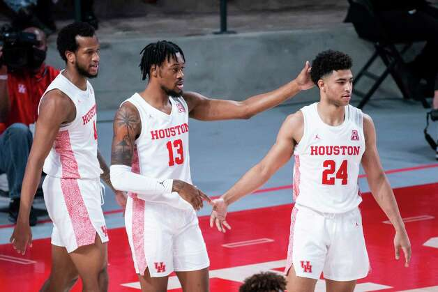 Houston Cougars forward Justin Gorham (4), forward J'Wan Roberts (13) and guard Quentin Grimes (24) celebrate after a defensive stop during the first half of a game between the University of Houston Cougars and the Wichita State Shockers on Wednesday, Jan. 6, 2021, at the Feritta Center in Houston. Photo: Mark Mulligan, Staff Photographer / © 2021 Mark Mulligan / Houston Chronicle