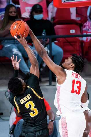 Houston Cougars forward J'Wan Roberts (13) blocks a shot by Wichita State Shockers guard Alterique Gilbert (3) during the first half of a game between the University of Houston Cougars and the Wichita State Shockers on Wednesday, Jan. 6, 2021, at the Feritta Center in Houston. Photo: Mark Mulligan, Staff Photographer / © 2021 Mark Mulligan / Houston Chronicle