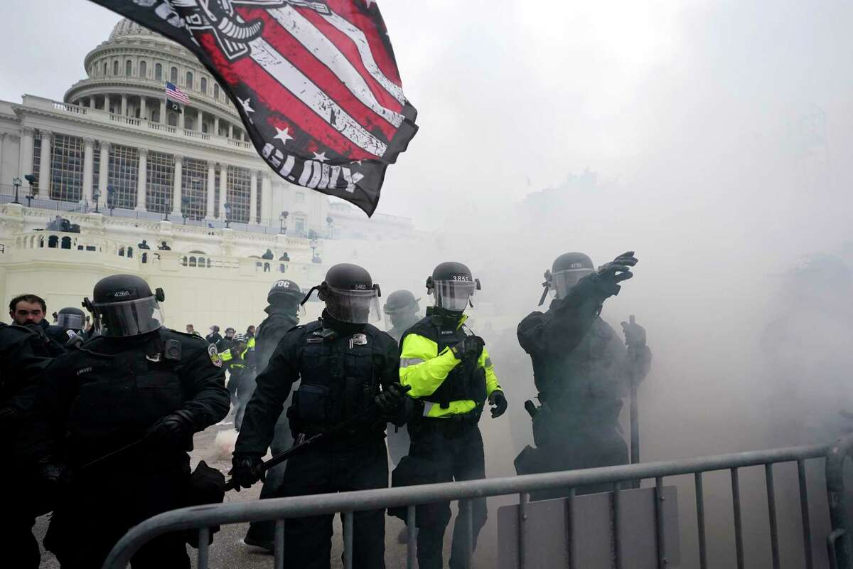 Police hold off Trump supporters who tried to break through a police barrier, Wednesday, Jan. 6, 2021, at the Capitol in Washington. As Congress prepares to affirm President-elect Joe Biden's victory, thousands of people have gathered to show their support for President Donald Trump and his claims of election fraud.