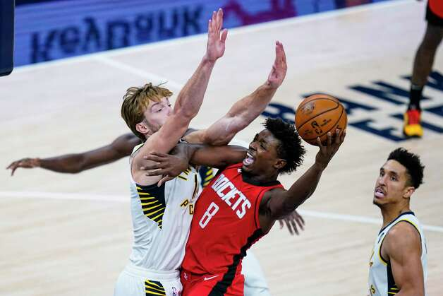 Houston Rockets forward Jae'Sean Tate (8) shoots over Indiana Pacers forward Domantas Sabonis (11) during the fourth quarter of an NBA basketball game in Indianapolis, Wednesday, Jan. 6, 2021. (AP Photo/Michael Conroy) Photo: Michael Conroy, Associated Press / Copyright 2021 The Associated Press. All rights reserved.
