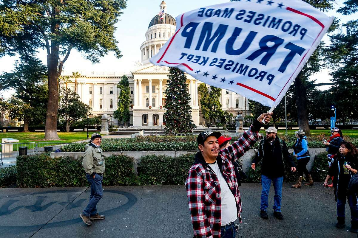 John, who declined to give a last name, protests in support of President Trump outside the California State Capitol on Jan. 6 in Sacramento.